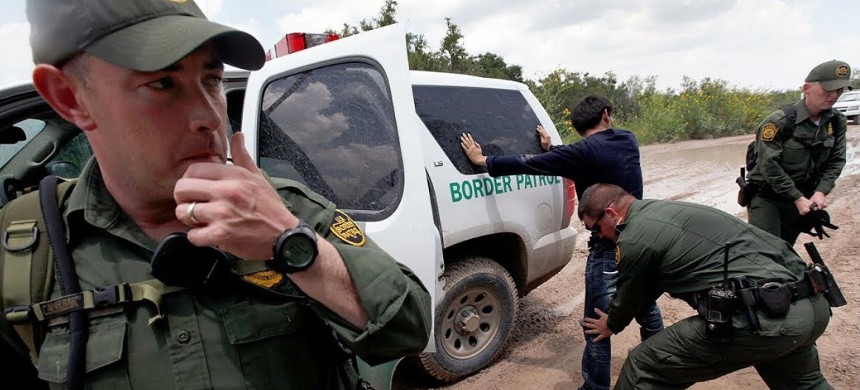 Border Patrol agents detain an undocumented immigrant. (photo: Getty)