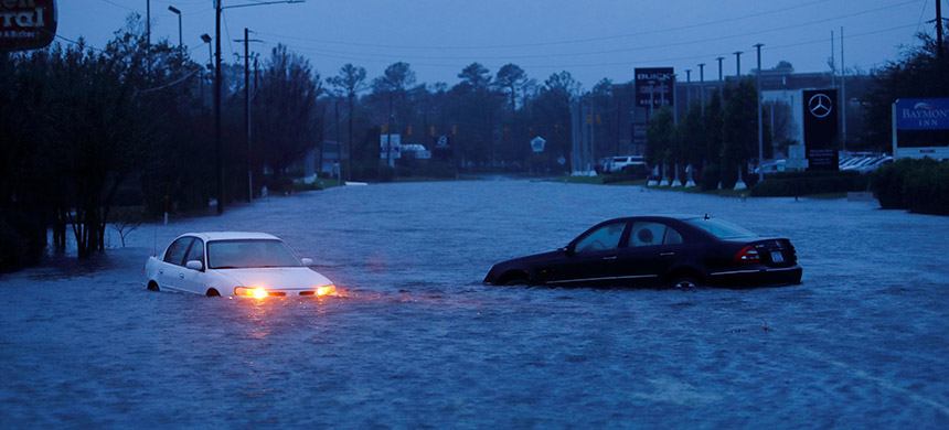 Rising floodwaters in Wilmington, North Carolina. (photo: Quartz)