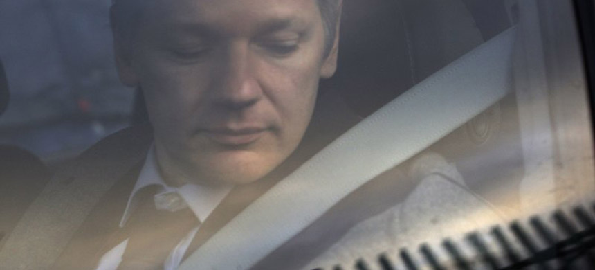 WikiLeaks founder Julian Assange arrives at Belmarsh Magistrate's court in London for an extradition hearing in 2011. (photo: Sang Tan/AP)