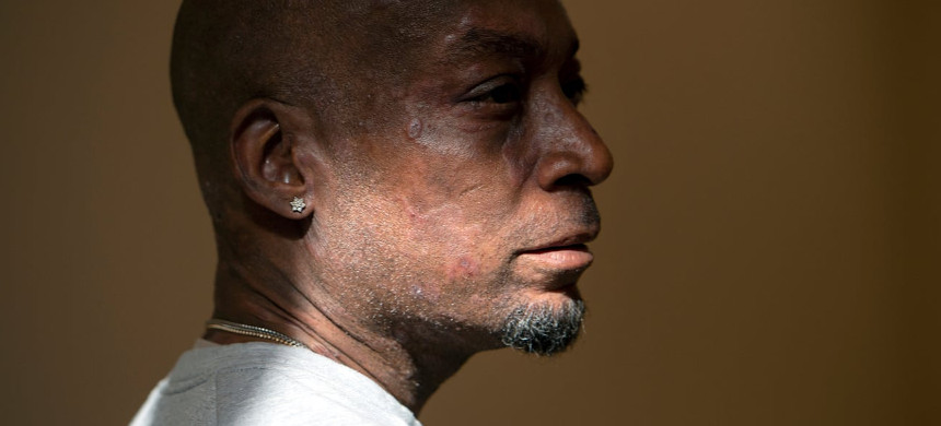 Dewayne Johnson looks on after hearing the verdict in his case against Monsanto. A California jury ordered the company to pay m to the former school groundskeeper dying of cancer. (photo: Josh Edelson/AP)