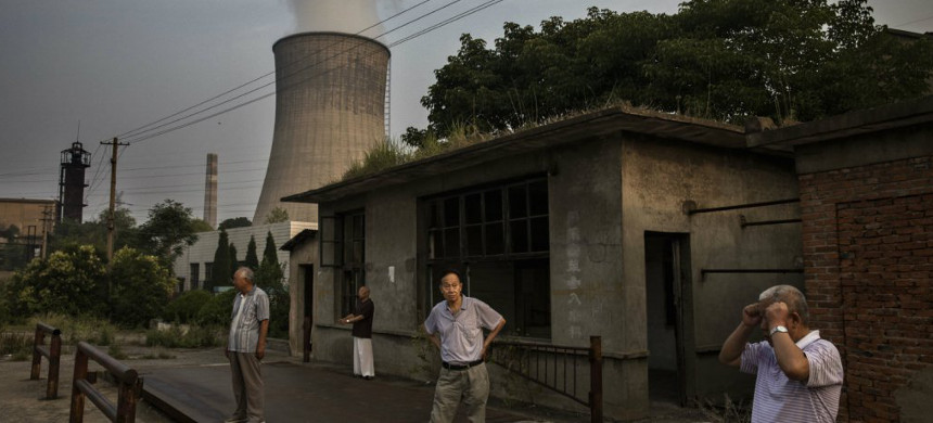 Community living near a power plant in China. (photo: Kevin Frayer/Getty)