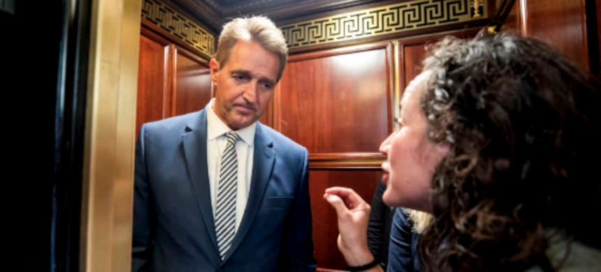 Jeff Flake was confronted by two women who said they were survivors of sexual assault. (photo: Jim Lo Scalzo/Shutterstock)