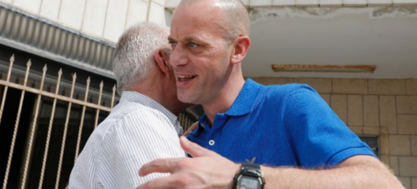 French-Palestinian lawyer Salah Hamouri embraces his father Hassan after being released from an Israeli prison on September 30, 2018. (photo: Ahmad Gharabli/AFP)