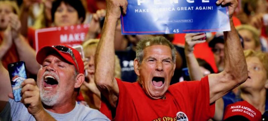 Local residents react as President Donald Trump arrives at a rally in Huntington, West Virginia, U.S., August 3, 2017. (photo: Carlos Barria/Reuters)