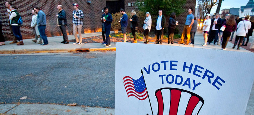 Voters line up to vote in Grand Rapids, Michigan in 2016. (photo: Cory Morse/AP)