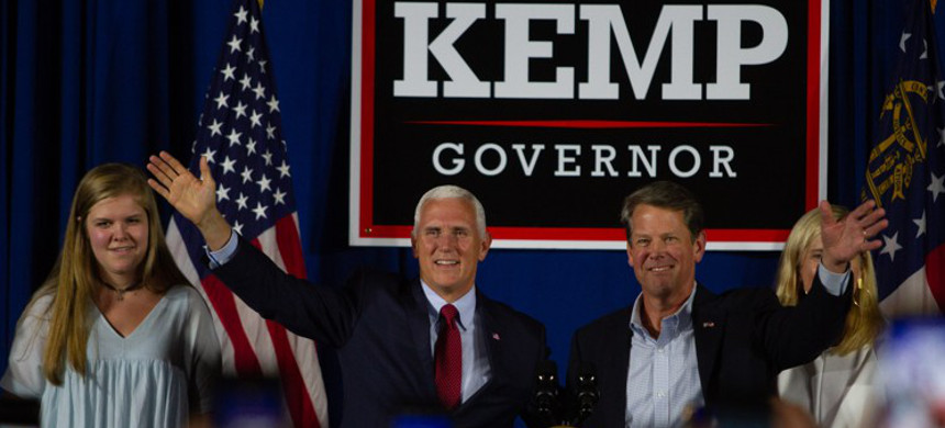 Vice President Mike Pence and Secretary of State Brian Kemp talk at a rally in Macon GA Saturday, July 21, 2018. Vice President Mike Pence endorsed Kemp for Governor during the event. (photo: Steve Schaefer/AJC)