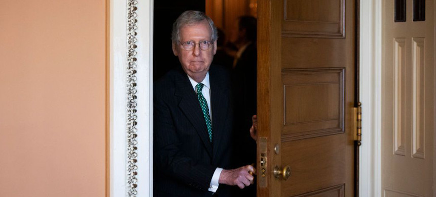 Mitch McConnell leaves a meeting of Republican Senators at the U.S. Capitol on October 3. (photo: Drew Angerer/Getty)
