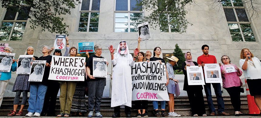 Protesters during a rally against Saudi Arabia's murder of the Washington Post contributing columnist Jamal Khashoggi outside the Embassy of Saudi Arabia on Wednesday. (photo: Jacquelyn Martin/AP)