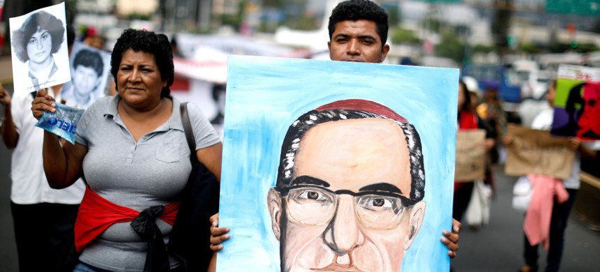 People carry a portrait of the Óscar Romero during a demonstration to ask to reopen the case of his murder. Romero will be declared saint by the Catholic church on 14 October. (photo: Jose Cabezas/Reuters)