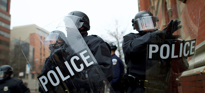 Police in riot gear. (photo: Getty Images)
