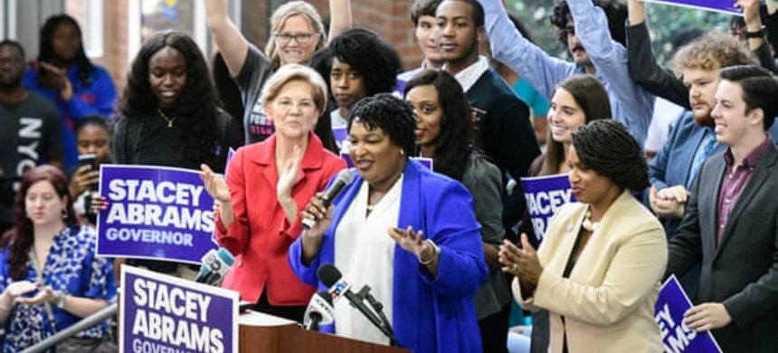 Stacey Abrams, Democratic challenger for Georgia governor in November 2018's midterm elections, at a rally supported by Democratic Senator from Massachusetts Elizabeth Warren. (photo: John Amis/EPA)