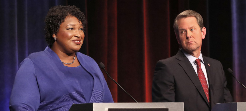 Stacey Abrams, Georgia's Democratic nominee for governor, and Secretary of State Brian Kemp, the GOP nominee, debate in Atlanta on Oct. 23, 2018. (photo: John Bazemore/AP)