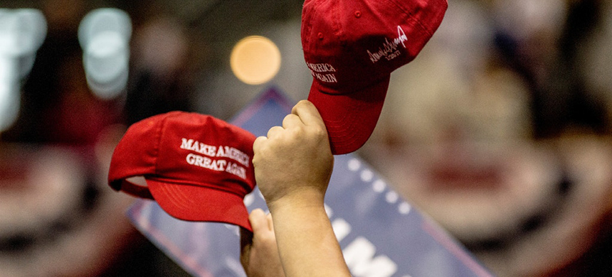 Supporters hold up their hats during a rally held by President Trump on March 15, 2017 in Nashville, Tenn. (photo: Andrea Morales/Getty Images)
