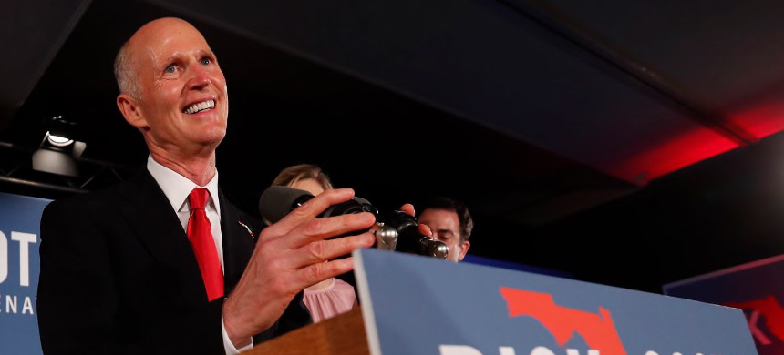 Republican Senate candidate Rick Scott, seen on election night, was holding onto a narrow lead that, if it is maintained, could require a recount. (photo: Wilfredo Lee/AP)