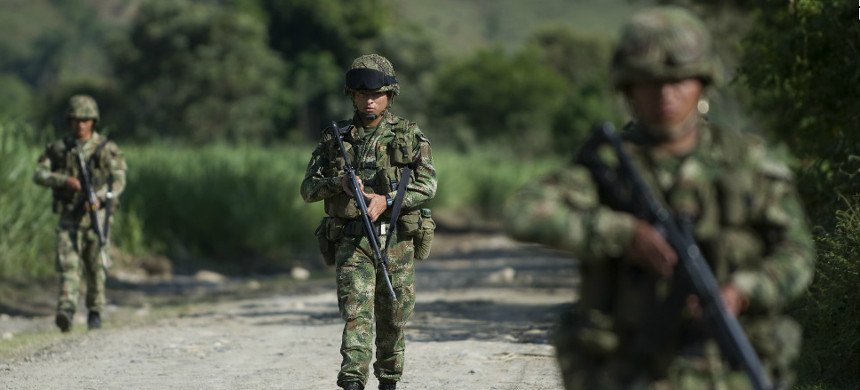 Colombian soldiers patrol along a dirt road in Miranda, Colombia, on January 18, 2012. (photo: Getty)