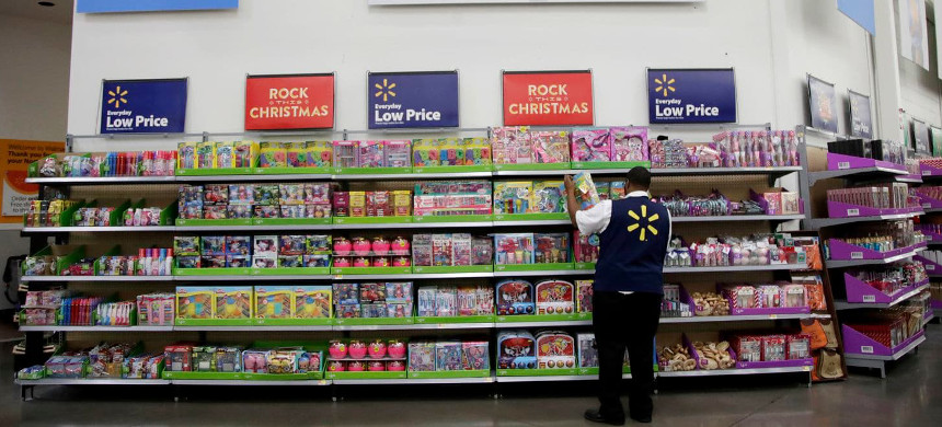 Walmart employee Kenneth White scans items while conducting an exercise during a Walmart Academy class session at the store in North Bergen, N.J. Walmart will be rolling out a program that allows its staff to check out customers and provide receipts right on the spot in the busiest sections of the store. (photo: Julio Cortez/AP)