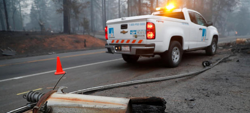 An electricity pole damaged by the Camp Fire lies near a Pacific Gas & Electric truck in Paradise, California, U.S., November 14, 2018. (photo: Terray Sylvester/Reuters)