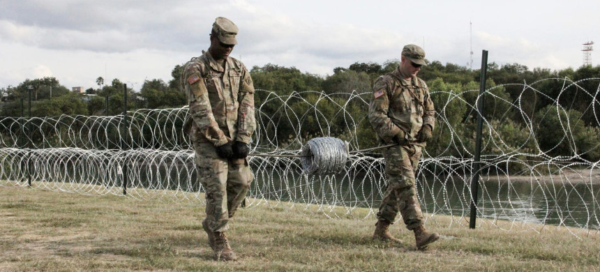 U.S. military lays out barbed wire on border with Mexico. (photo: Thomas Watkins/AFP/Getty)