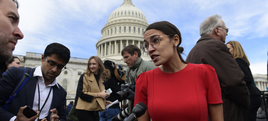 Rep.-elect Alexandria Ocasio-Cortez, D-NY, talks with reporters following a photo opportunity on Capitol Hill in Washington, with the freshman class. (photo: Susan Walsh/AP)