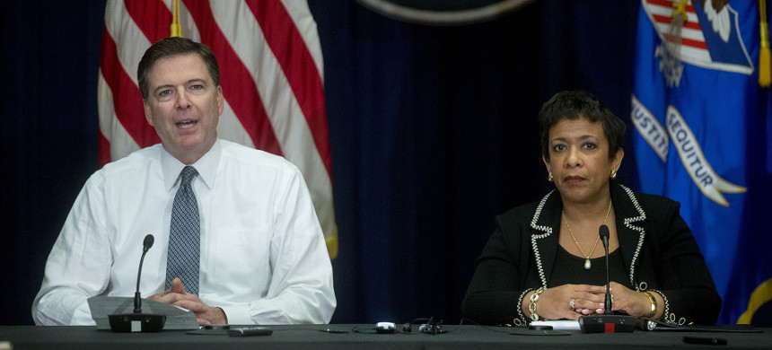 James B. Comey and Loretta E. Lynch during a news conference in 2016. They have each received a subpoena requiring them to appear in closed-door sessions with House lawmakers. (photo: Getty)