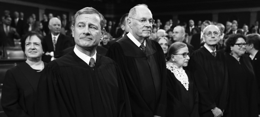 Chief Justice John Roberts stands with U.S. Supreme Court Justices in the House chamber  prior to the 2016 State of the Union address. (photo: Reuters)