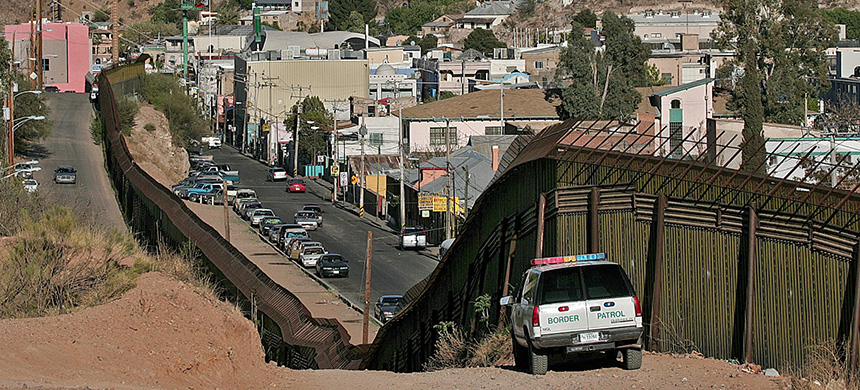 The border fence separating Nogales, Ariz. from Nogales, Sonora, Mexico. In 2012 a Mexican teenager was shot and killed by a border patrol agent shooting through the fence. Last week, the agent was found not-guilty of involuntary manslaughter. (photo: Matt York/AP)