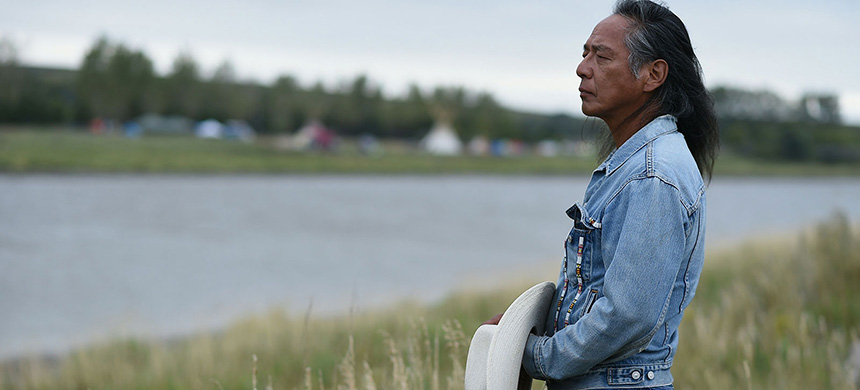 Ron His Horse Is Thunder, a spokesperson for the Standing Rock Sioux Tribe, looks over a river during Dakota Access pipeline protests in 2016. (photo: Robyn Beck/AFP/Getty Images)