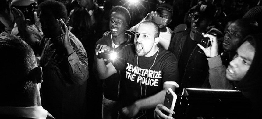 Bassem Masri, center, confronting a St. Louis police officer in Ferguson, Missouri on Wednesday, Oct. 8, 2014. (photo: David Carson/Getty)