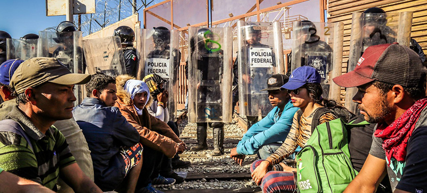 Members of the caravan are being met with growing resistance in Tijuana, where that city's mayor has declared a humanitarian crisis. Conditions escalated on November 25 when U.S. authorities closed the busiest port of entry there and fired tear gas on refugees and migrants who had rushed the fencing between the two countries. (photo: Rob Wilson)