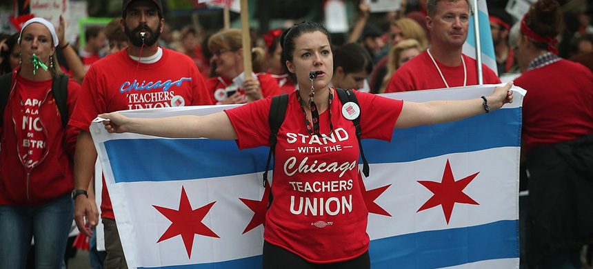 Striking Chicago public school teachers march down Michigan Avenue in 2012 in Chicago. (photo: Getty Images)