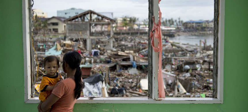 A woman looks over the devastated waterfront in Tacloban, Philippines on November 24. (photo: Odd Anderson/Getty)