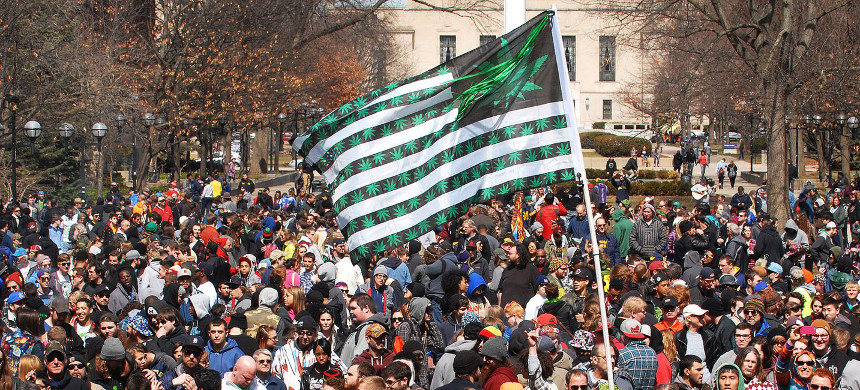 A 2015 pro-weed rally in Michigan. On Thursday, the plant is officially legal for people 21 and over, though sales have not yet begun. (photo: Paul Warner/Getty)