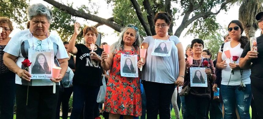 Dozens of family members and friends of four women who authorities say were killed by U.S. Border Patrol agent Juan David Ortiz gather for a candlelight vigil at a park in downtown Laredo, Texas, September 18, 2018. (photo: Susan Montoya Bryan/Shutterstock)