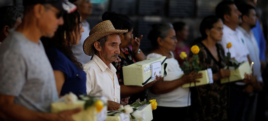 Relatives participate in a ceremony to commemorate the 37th anniversary of El Mozote massacre in Meanguera, El Salvador. (photo: Jose Cabezas/Reuters)