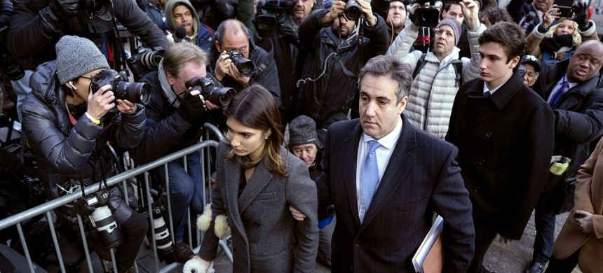 Michael Cohen, center, President Donald Trump's former lawyer, accompanied by his children Samantha, left, and Jake, right, arrives at federal court for his sentencing. (photo: Craig Ruttle/AP)