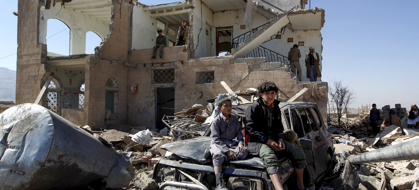 Children sit amid the rubble of a house hit by Saudi-led coalition airstrikes two days earlier on the outskirts of the Yemeni capital Sana'a, November 14, 2016. (photo: Mohammed Huwais/Getty)