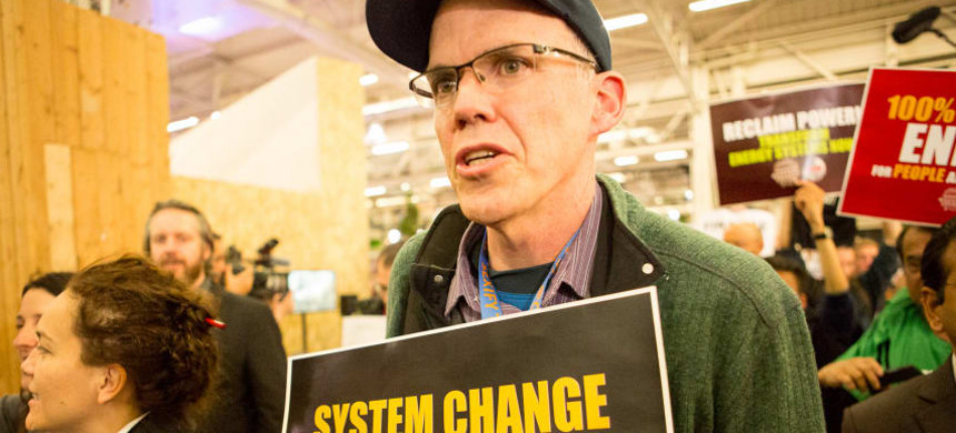 Bill McKibben during a sit-in at the Paris climate summit. (photo: Emma Cassidy/Survival Media Agency)