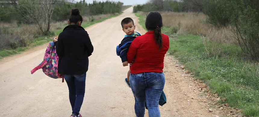 Central American migrants walk after crossing the US-Mexico border to turn themselves into border patrol agents near McAllen, Texas. (photo: John Moore/Getty Images)