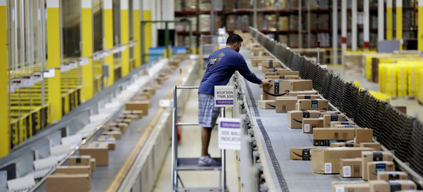 An employee works at the Amazon Fulfillment center in Robbinsville Township, N.J. (photo: Julio Cortez/AP)