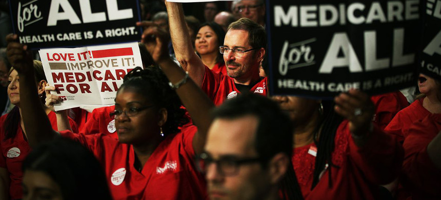 Supporters of Senator Bernie Sanders hold up signs in support for Medicare-for-all during a health care rally in Washington D.C. on September 13, 2017. (photo: Getty)