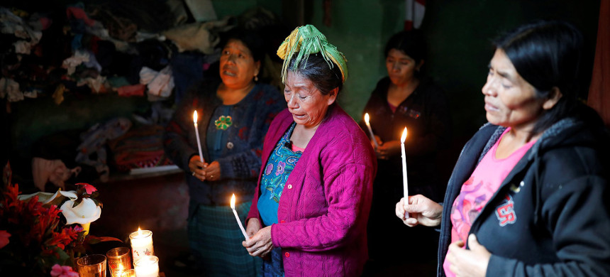 Catarina Perez, center, the grandmother of Felipe Gòmez Alonzo, 8, who died while in the custody of U.S. Customs and Border Protection, cries Thursday as she prays for her grandson in Guatemala. (photo: Luis Echeverria/Reuters)