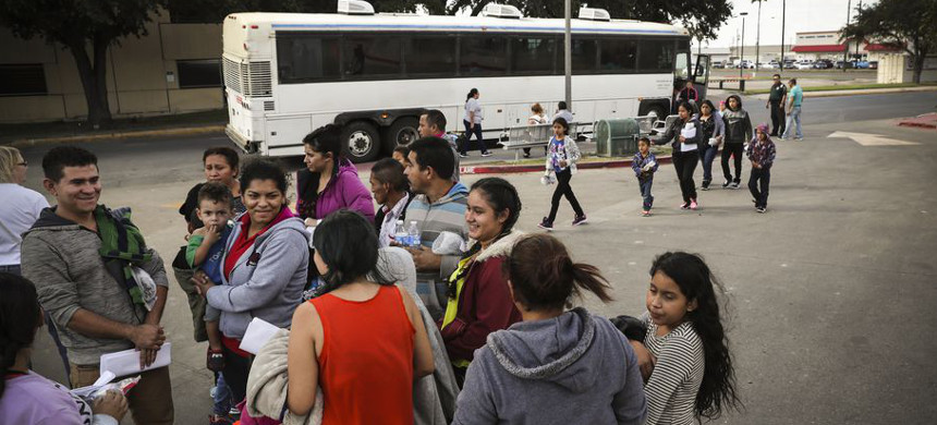 Immigrants, most seeking political asylum, are dropped off at a bus station after being released from U.S. government detention on November 3, 2018, in McAllen, Texas. (photo: John Moore/Getty)