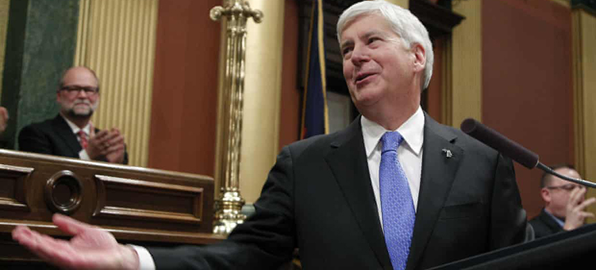Republican governor Rick Snyder signed laws to significantly scale back citizen-initiated measures to raise Michigan's minimum wage and require paid sick leave for workers. (photo: Al Goldis/AP)