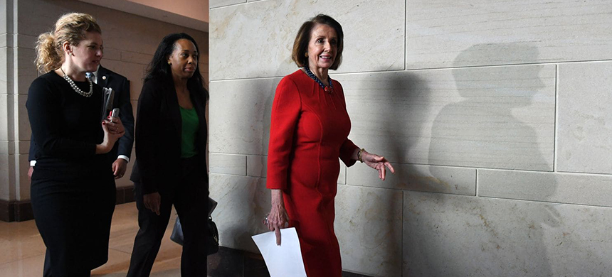 Nancy Pelosi (D-Calif.) leaves a meeting at the U.S. Capitol on Dec. 12, 2018. (photo: Matt McClain/AP)
