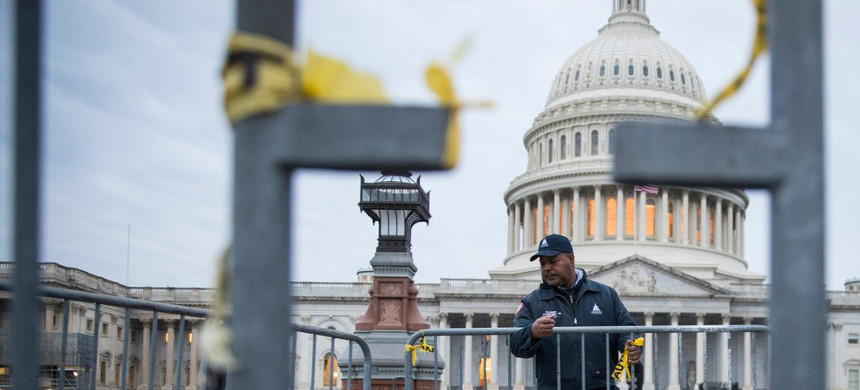 A maintenance worker arranged barriers outside the Capitol on Thursday morning before members of the 116th Congress were sworn in. (photo: Sarah Silbiger/The New York Times)