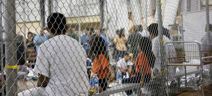 Immigrants in detention. (photo: AP)