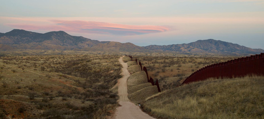 Donald Trump is pushing an expansion of the border wall between the U.S. and Mexico, seen here east of Nogales, Arizona. But environmentalists say that could cause problems. (photo: Richard Misrach/National Geographic)