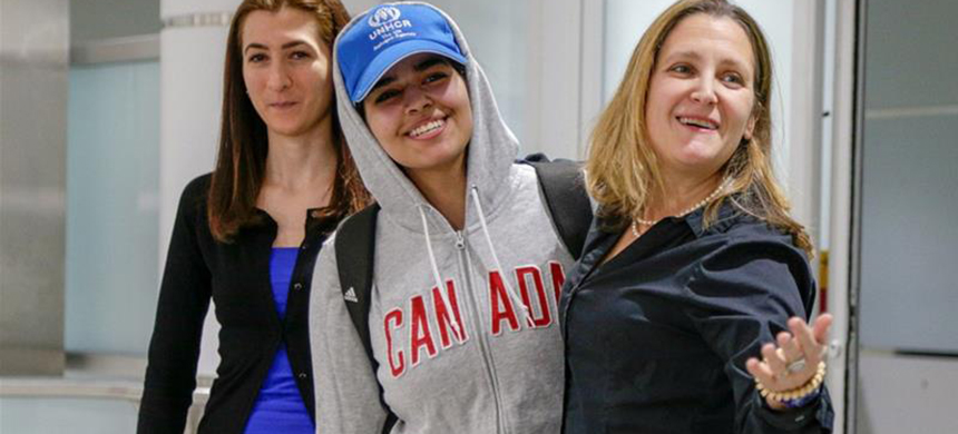 Rahaf Mohammed al-Qunun is welcomed by Canada's Foreign Minister Chrystia Freeland at Toronto airport. (photo: Carlos Osorio/Reuters)