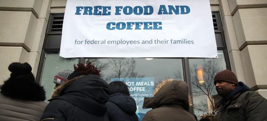 People line up to get a free lunch at a pop-up eatery hosted by Celebrity Chef Jose Andres for furloughed government employees and their families, on January 16, 2019 in Washington, DC. (photo: Mark Wilson/Getty)