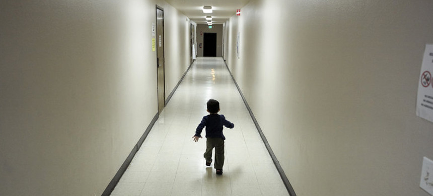 An asylum-seeking boy from Central America runs down a hallway in December after arriving at a shelter in San Diego. Immigrant advocates say they are suing the U.S. government for allegedly detaining immigrant children too long and improperly refusing to release them to relatives. (photo: Gregory Bull/AP)